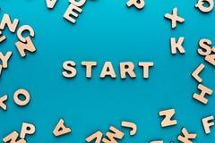 Começo da palavra no fundo azul Foto de Stock Royalty Free