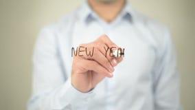 Começo novo do ano novo, escrita do homem na tela transparente vídeos de arquivo