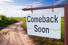 Come back soon. Wood sign with country road Royalty Free Stock Photo