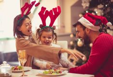 Come on Dad with us to play. Family at home for Christmas stock photo