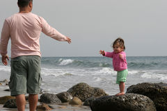 Come get Me !!. Daughter reaching for her father at the Beach royalty free stock photography