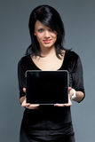 Come get this new touch pad. Sexy brunette model presents new touch pad device. One of collection Royalty Free Stock Photos