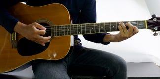 Come giocare una chitarra Immagine Stock