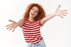 Come on give me. Energized lively smiling optimistic redhead curly woman tilt head joyfully stretch hands forward hug. Cuddles wanna hold tight friend inviting stock photography