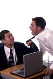 Come here. Mad employee pulls on his bosses tie Royalty Free Stock Images