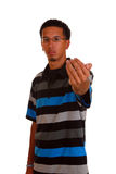 Come here. Young hispanic male with hand gesture to come close Royalty Free Stock Photo