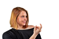 Come here!. Come here. A young woman calls out with her finger Stock Image