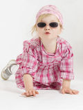 Come and kiss me. Adorable little caucasian white girl in pink clothes is making a kissing mouth. She is wearing sunglasses. Image taken on white background Royalty Free Stock Photography