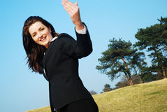 Come with me!. A beautiful young businesswoman encouraging you to come with her in a field Royalty Free Stock Photography