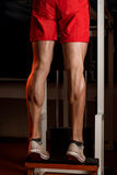 Come Into My World. Bodybuilders Legs Shot In A Gym In Workout Stock Photography