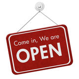 Come in We are Open Sign. A red hanging sign with text Come in We are Open isolated over white Royalty Free Stock Photography