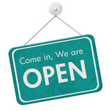 Come in We are Open Sign. A teal hanging sign with text Come in We are Open isolated over white Stock Photo