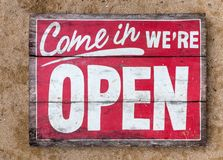 Come in we`re OPEN - handpainted sign on wood, old Stock Photo