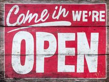 Come in we`re OPEN - handpainted sign on wood, old. No background. Stock Image