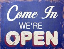 Come in we're open. Come in, we're open - sign Stock Images