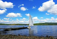 Come Sail Away. A yacht and a lake all to your own Stock Image