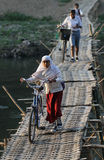 Come school, number of students crossing the bamboo bridge river river solo in the morning Royalty Free Stock Photography