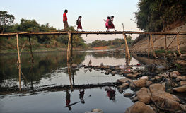 Come school, number of students crossing the bamboo bridge river river solo in the morning, Royalty Free Stock Photos