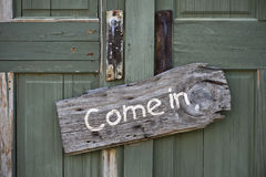 Come in sign on door Stock Photo