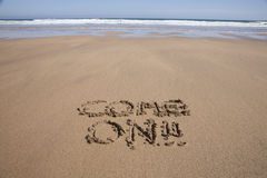 Come on text in sand beach Stock Image