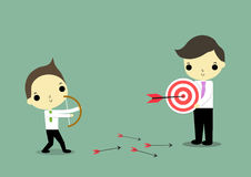 Come to goal. A man with bow and a man with aim on green background Stock Photos