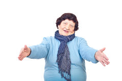 Come to grandma!. Elderly woman standing with arms open ready for hugging someone isolated on white background Royalty Free Stock Photo