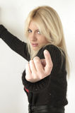 Come to Me. Blond female poses sideways with hand outstretched.  Index finger crooked beckoning come here Stock Photos