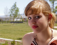 Come to the Park With Me. Alluring young woman basking in the sunshine of the park Stock Photos