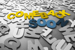 Comeback Soon. Color Comeback Soon word in scattered black and white wood letters Stock Photos