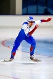 Comece o homem de patinagem de uma velocidade de 500 m Imagem de Stock Royalty Free