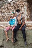 Comedia Del Art Men. Handsome comedia del arte male performers sitting outside Royalty Free Stock Images