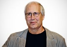 Chevy Chase. Comedian and actor Chevy Chase arrives on the red carpet for the premiere of raunchy comedy, `Baby Mama,` at the Ziegfeld Theater in Manhattan on Royalty Free Stock Photo