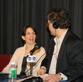Tina Fey, and Al Franken. Comedian, writer, actor and producer Tina Fey joins comic and political humorist, Al Franken, during a broadcast of `The Al Franken Royalty Free Stock Photo