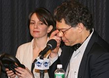 Tina Fey, and Al Franken. Comedian, writer, actor and producer Tina Fey joins comic and political humorist, Al Franken, during a broadcast of `The Al Franken Stock Image