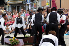 Comedians near a coffin Stock Images