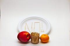Comedor criticón - Apple y naranja imagen de archivo
