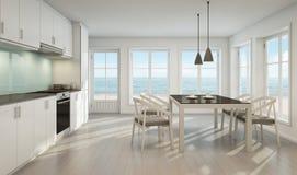 Comedor y cocina de la opinión del mar en casa de playa Foto de archivo libre de regalías