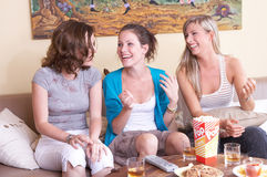 Comedy. Girls having a party in their livingroom Stock Images