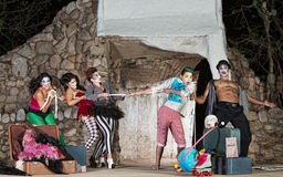 Comedy Actors Tug-Of-War. Group of silly cirque clowns playing tug-of-war Royalty Free Stock Photos