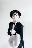 Comedy mime artist in glasses and makeup mask stock photo