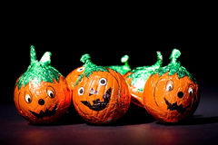 Comedy pumpkin chocolates close up on black royalty free stock images