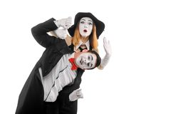 Comedy show of two mimes. Man and women showing funny performance, fooling and monkeying. Humorous sketch royalty free stock photography