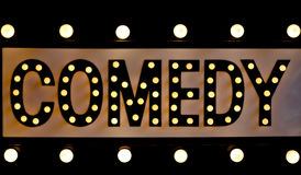 Comedy sign in lights. Retro comedy sign on black with old fashioned lights Royalty Free Stock Photo