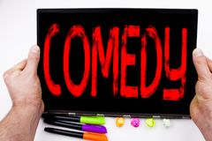 Comedy text written on tablet, computer in the office with marker, pen, stationery. Business concept for Stand Up Comedy Microphon. E white background with space Stock Images