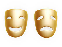Comedy and tragedy masks. Gold comedy and tragedy masks isolated over white background Royalty Free Stock Photography