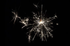 Comemore fogos-de-artifício pequenos do chuveirinho do partido no fundo preto Imagem de Stock Royalty Free