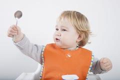 Comendo a colher acima Imagem de Stock