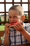 Comendo a melancia fotografia de stock royalty free