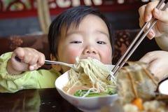 Comendo o bebê imagem de stock royalty free