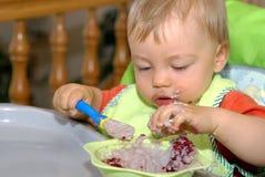Comendo o bebê imagem de stock